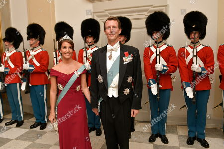Princess Marie (L) and Prince Joachim (R) arrive to the State Banquet at Christiansborg Palace in connection with the French President's official visit to Copenhagen, Denmark, 28 August 2018. The French President and his wife are on a two-day state visit to Denmark.