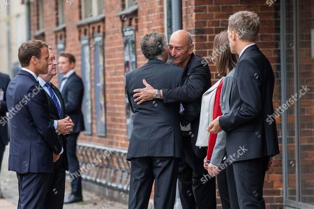 Sergeant Uzan (3-R), father of Dan Uzan, who was killed by the terrorist Omar El-Hussein embraces the French ambassador Francois Zimeray (C), as French President Emmanuel Macron (L), Denmark Prime Minister Lars Loekke Rasmussen (2-L) and French Ambassador meet relatives of the victims of the terrorist attacks in Copenhagen in 2015, at the Krudttoenden during the French President official visit in Copenhagen, Denmark, 28 August 2018. The French President and his wife are on a two-day state visit to Denmark.