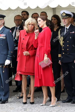 Crown Princess Mary of Denmark (R) talks with French President's wife Brigitte Trogneux during a wreath-laying ceremony at the monument for fallen soldiers at the Citadel in Copenhagen, Denmark
