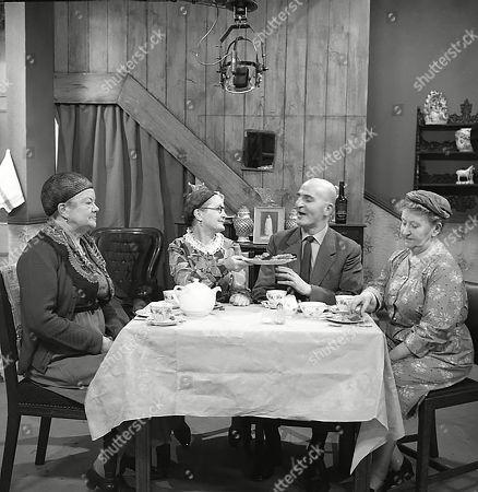 Violet Carson (as Ena Sharples), Lynne Carol (as Martha Longhurst), Jerrold Wells (as Ted Ashley) and Margot Bryant (as Minnie Caldwell)