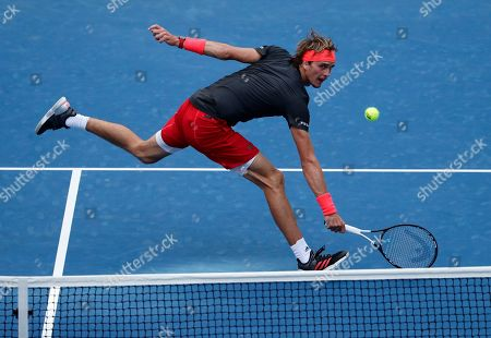 Alexander Zverev, of Germany, volleys to Peter Polansky, of Canada, during the first round of the U.S. Open tennis tournament, in New York