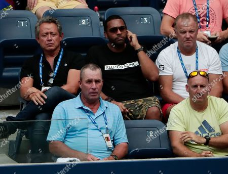 Tennis great Ivan Lendl, lower left, watches as Alexander Zverev, of Germany, plays Peter Polansky, of Canada, during the first round of the U.S. Open tennis tournament, in New York