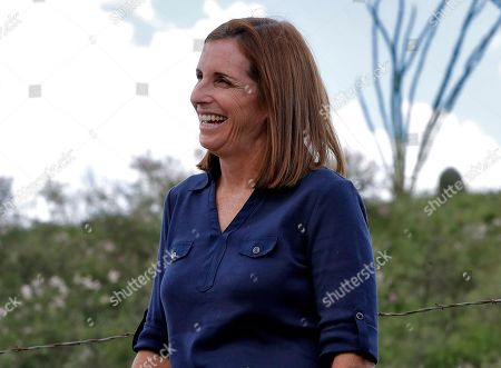 Stock Picture of U.S. Senatorial candidate U.S. Rep. Martha McSally, R-Ariz., laughs while touring the international border with Mexico, south of Arivaca, Ariz. In her bid to become the Republican Senate nominee, McSally is facing former Maricopa County Sheriff Joe Arpaio and Dr. Kelli Ward for the republican nomination in Tuesday's statewide primary