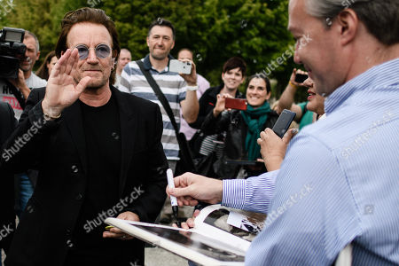 The singer of the Irish rock group U2 and co-founder of the campaign organization ONE, Paul David Hewson aka Bono Vox (L), waves goodbye to fans after a visit to German Chancellor Angela Merkel (not in the picture), in front of the chancellery in Berlin, Germany, 28 August 2018. Bono met German Chancellor Angela Merkel prior to her Africa visit for a talk.