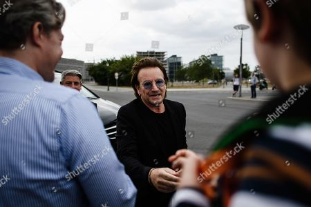 The singer of the Irish rock group U2 and co-founder of the campaign organization ONE, Paul David Hewson aka Bono Vox (C), talks to fans after a visit to German Chancellor Angela Merkel (not in the picture), in front of the chancellery in Berlin, Germany, 28 August 2018. Bono met German Chancellor Angela Merkel prior to her Africa visit for a talk.