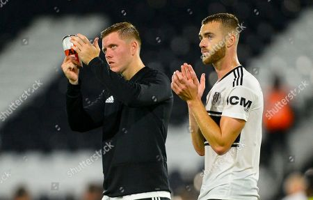 Alfie Mawson of Fulham and Calum Chambers of Fulham at full time