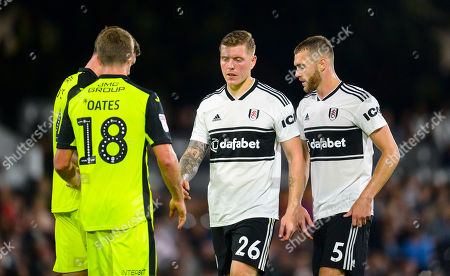 Alfie Mawson and Calum Chambers of Fulham with Jimmy Oates of Exeter City