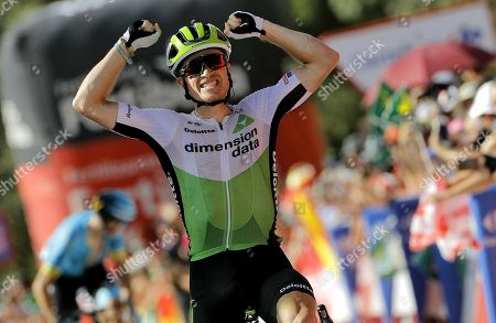 US cyclist Benjamin King of Dimension Data celebrates winning the fourth stage of the La Vuelta 2018 cycling tour over 161.4km from Velez to Alfaguara Mountains, Spain, 28 August 2018.