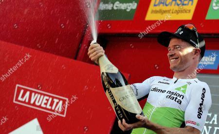 US cyclist Benjamin King of Dimension Data celebrates on the podium after winning the fourth stage of the La Vuelta 2018 cycling tour over 161.4km from Velez to Alfaguara Mountains, Spain, 28 August 2018.