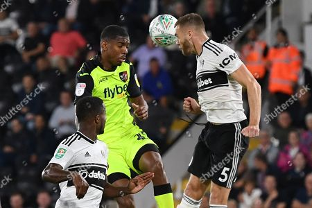 Tristan Abrahams of Exeter City battles with Calum Chambers of Fulham