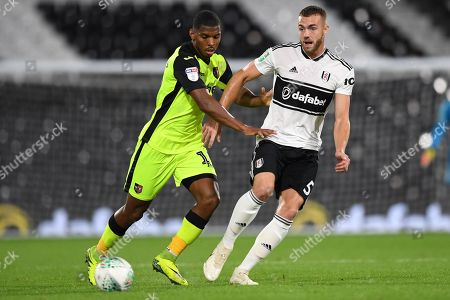 Calum Chambers of Fulham battles with Tristan Abrahams of Exeter City
