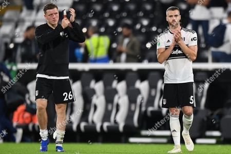 Alfie Mawson of Fulham and Calum Chambers of Fulham  applaud the fans at the final whistle