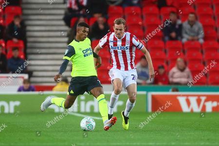 Huddersfield's Juninho Bacuna and Stoke's Darren Fletcher