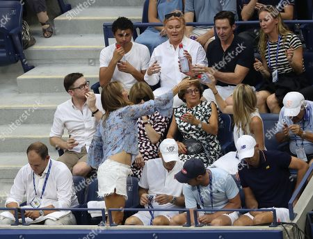 Mirka Federer, wife of Roger Federer, takes her seat in the Player's Box alongside Roger Federer's coaching team, Anna Wintour, Lynette Federer, Hugh Jackman and Deborra-lee Furness.