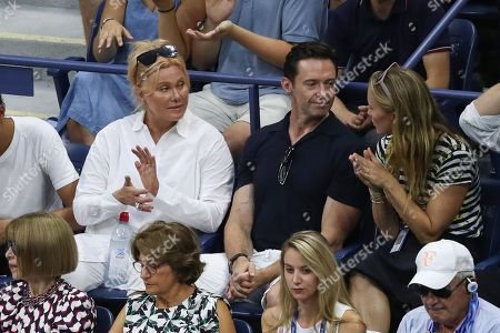 A view of Roger Federer's Player's Box as his wife Mirka Federer, his coaching team, Anna Wintour, Lynette Federer and Hugh Jackman with his wife Deborra-lee Furness react.