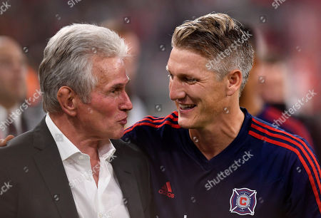 Stock Picture of Chicago's Bastian Schweinsteiger (R) welcomes Munich's former head coach Jupp Heynckes (L) prior to the farewell soccer match of Bastian Schweinsteiger between Bayern Munich and Chicago Fire in Munich, Germany, 28 August 2018.