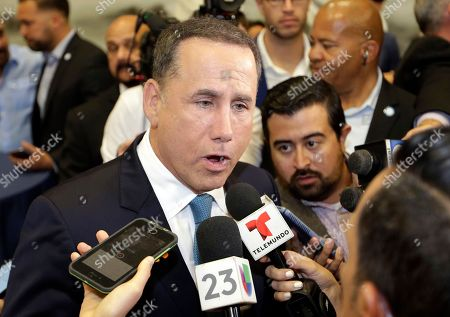 Democratic gubernatorial candidate Philip Levine talks to the news media after giving a concession speech, in Miami