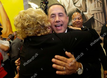 Democratic gubernatorial candidate Philip Levine hugs a supporter after giving a concession speech, in Miami