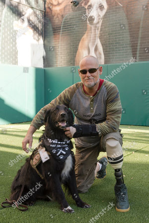 Veteran David Campbell and his service dog Caleb pose for the camera while enjoying time together on the PetSmart Patio at Chase Field on Saturday, August 25. To show appreciation for those who have served our country, PetSmart Charities hosted Military Veterans and their four-legged friends on the PetSmart Patio ahead of National Service Dog Month in September