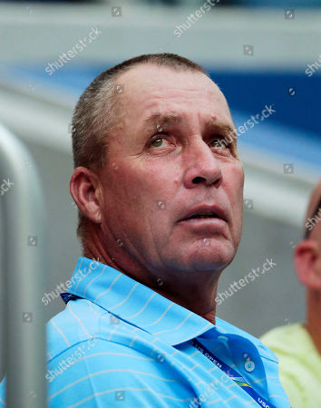 Retired tennis champion Ivan Lendl watches as Alexander Zverev, of Germany, play Peter Polansky, of Canada, during the first round of the U.S. Open tennis tournament, in New York