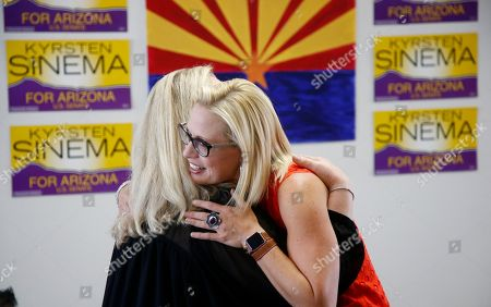 Rep. Kyrsten Sinema, D-Ariz., hugs a supporter at a Democratic campaign office on primary election day, in Phoenix. Sinema is seeking the current U.S. Senate seat occupied by outgoing Republican Sen. Jeff Flake, and will face the Republican primary winner of the race between Rep. Martha McSally, former state Sen. Kelli Ward, and former Maricopa County Sheriff Joe Arpaio, if Sinema wins the Democratic primary