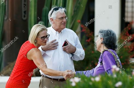 Rep. Kyrsten Sinema, D-Ariz., left, meets with voters at a polling station on primary election day, in Phoenix. Sinema is seeking the current U.S. Senate seat occupied by retiring Republican Sen. Jeff Flake, and will face the Republican primary winner of the race between Rep. Martha McSally, former state Sen. Kelli Ward, and former Maricopa County Sheriff Joe Arpaio, if Sinema wins the Democratic primary