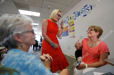 Rep. Kyrsten Sinema, D-Ariz., middle, talks to campaign volunteers at a Democratic campaign office on primary election day, in Phoenix. Sinema is seeking the current U.S. Senate seat occupied by outgoing Republican Sen. Jeff Flake, and will face the Republican primary winner of the race between Rep. Martha McSally, former state Sen. Kelli Ward, and former Maricopa County Sheriff Joe Arpaio, if Sinema wins the Democratic primary