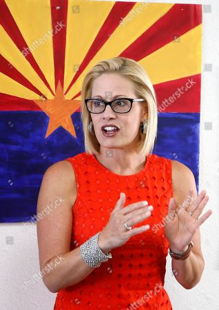 Rep. Kyrsten Sinema, D-Ariz., talks to campaign volunteers at a Democratic campaign office on primary election day, in Phoenix. Sinema is seeking the current U.S. Senate seat occupied by outgoing Republican Sen. Jeff Flake, and will face the Republican primary winner of the race between Rep. Martha McSally, former state Sen. Kelli Ward, and former Maricopa County Sheriff Joe Arpaio, if Sinema wins the Democratic primary