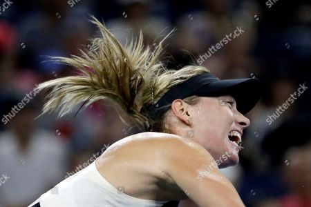 Maria Sharapova, of Russia, serves to Patty Schnyder, of Switzerland, during the first round of the U.S. Open tennis tournament, in New York