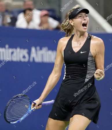Maria Sharapova, of Russia, reacts after a point against Patty Schnyder, of Switzerland, during the first round of the U.S. Open tennis tournament, in New York