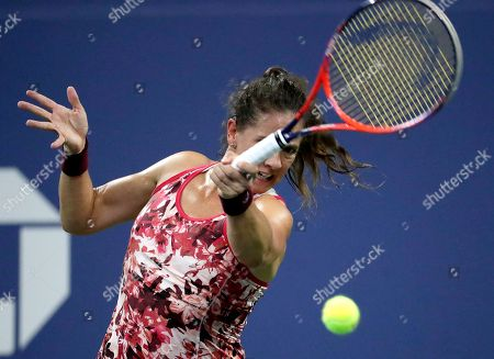 Patty Schnyder, of Switzerland, returns a shot to Maria Sharapova, of Russia, during the first round of the U.S. Open tennis tournament, in New York