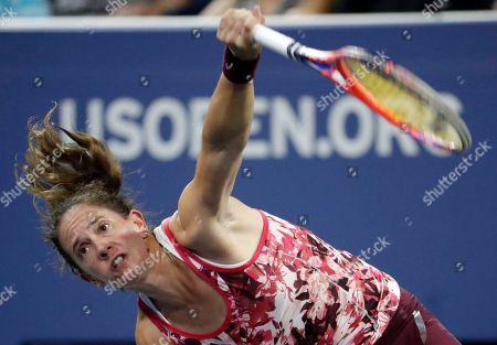 Patty Schnyder, of Switzerland, serves to Maria Sharapova, of Russia, during the first round of the U.S. Open tennis tournament, in New York