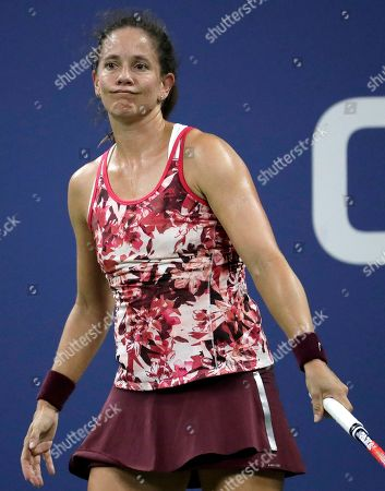 Patty Schnyder, of Switzerland, reacts after losing a point to Maria Sharapova, of Russia, during the first round of the U.S. Open tennis tournament, in New York