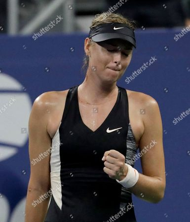 Maria Sharapova, of Russia, reacts after defeating Patty Schnyder, of Switzerland, during the first round of the U.S. Open tennis tournament, in New York