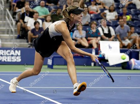 Maria Sharapova, of Russia, returns a shot to Patty Schnyder, of Switzerland, during the first round of the U.S. Open tennis tournament, in New York