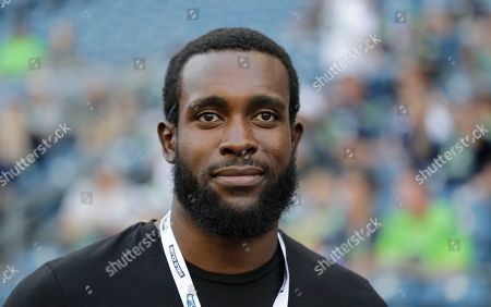 Stock Picture of Former Seattle Seahawks defensive back Kam Chancellor stands on the field before an NFL football preseason game against the Indianapolis Colts, in Seattle