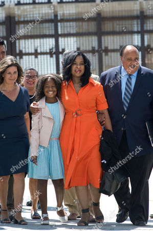Martin Luther King, III, right, walks at the US-Mexico border fence with his wife Arndrea Waters King, center, and their daughter, Yolanda Renee King, 10, during a visit to the border, in San Diego, California, USA, on 28 August 2018. King, who is the son of the late civil rights leader, Martin Luther King, Jr., gave a speech calling for support of immigrant rights and separated undocumented families detained at the border. His speech was given on the 55th anniversary of his father's seminal 'I Have a Dream' speech.