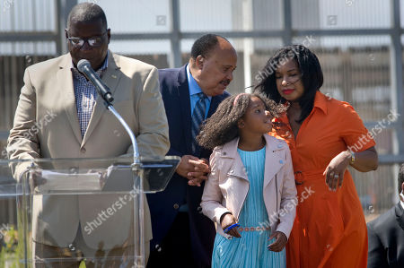 Martin Luther King, III, chats with his wife Arndrea Waters King and their daughter, Yolanda Renee King, 10, during a visit to the U.S.-Mexico border fence, background, in San Diego, California, USA, on 28 August 2018. King, who is the son of the late civil rights leader, Martin Luther King, Jr., gave a speech calling for support of immigrant rights and separated undocumented families detained at the border. His speech was given on the 55th anniversary of his father's seminal 'I Have a Dream' speech.