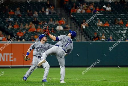 Stock Image of Aledmys Diaz, Billy McKinney. Toronto Blue Jays left fielder Billy McKinney, left, and third baseman Aledmys Diaz come up short as they try to catch a foul pop-up that was hit by Baltimore Orioles' Chris Davis in the eighth inning of a baseball game, in Baltimore
