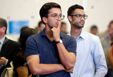 Hugo Cardona watches election returns at a watch party for Democratic gubernatorial candidate Philip Levine, in Miami