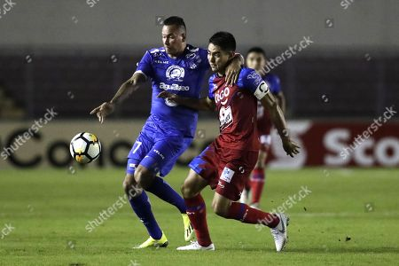 Blas Perez (L) of Arabe Unido vies for the ball with Raul Renderos (R) of the CD FAS during the CONCACAF League first leg quarterfinals soccer match between CD FAS of El Salvador and Arabe Unido of Panama held at the Rommel Fernandez National Stadium in Panama City, Panama, 28 August 2018.