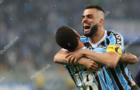 Andre (L) and Maicon (R) of Gremio celebrate a penalty goal during the Copa Libertadores soccer match between Gremio and Estudiantes at the Arena do Gremio Stadium in Porto Alegre, Brazil, 28 August 2018.