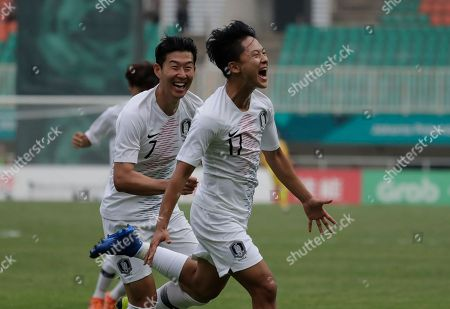 South Korea's Lee Seung-woo celebrates his goal with teammate Son Heung-min after scoring during their men's semifinal soccer match against Vietnam at the 18th Asian Games in Bogor, West Java, Indonesia
