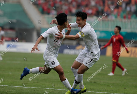 South Korea's Lee Seung-woo, left, celebrates his goal with teammate Son Heung-min after scoring during their men's semifinal soccer match against Vietnam at the 18th Asian Games in Bogor, West Java, Indonesia
