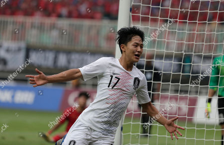 South Korea's Lee Seung-woo celebrates his goal after scoring during their men's semifinal soccer match against Vietnam at the 18th Asian Games in Bogor, West Java, Indonesia