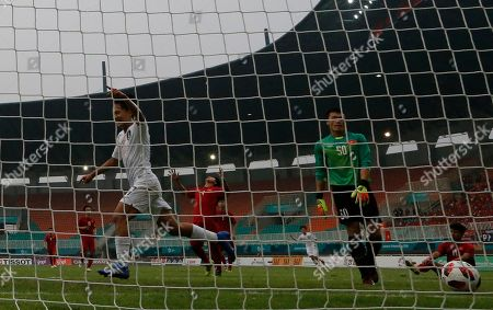 South Korea's Lee Seung-woo, left, celebrates his goal after scoring as Vietnam's goalkeeper Tien Dung Bui, right, looks at the ball during their men's semifinal soccer match at the 18th Asian Games in Bogor, West Java, Indonesia