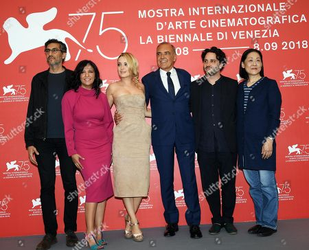 Stock Image of Members of the Venezia Opera Prima 'Luigi De Laurentiis' jury (L-R) Ramin Bahrani, Carolina Crescentini, Film Festival Director Alberto Barbera, Kaouther Ben Hania, Hayashi Kanako and Gaston Solnicki, pose during a photocall at the 75th annual Venice International Film Festival, in Venice, Italy, 29 August 2018. The  festival runs from 29 August to 08 September 2018.