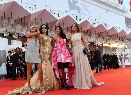(L-R) Jo Squillo, Gessica Notaro, Giusy Versace and a guest arrive for the opening ceremony and screening of 'First Man' at the 75th annual Venice International Film Festival, in Venice, Italy, 29 August 2018. The festival runs from 29 August to 08 September.