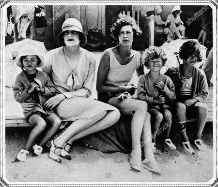 From Left to Right: Patricia Mountbatten (1924- ) Lady Edwina Mountbatten Née Ashley (1901-1960) Mrs Richard Norton Miss Sarah Norton and John Norton at Deauville Normandy. Unattributed Photograph in the Sketch, 22 August 1928