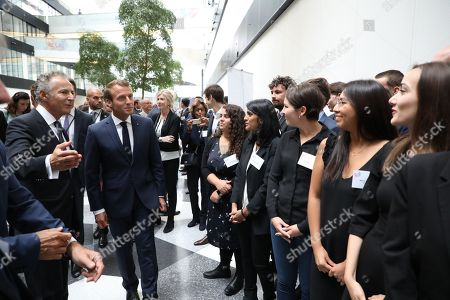 French President Emmanuel Macron (2ndL) and French Ambassador to Denmark Francois Zimeray (L) greet people during a visit at the Confederation of Danish Industry (DI) headquarters on August 29, 2018 in Copenhagen.